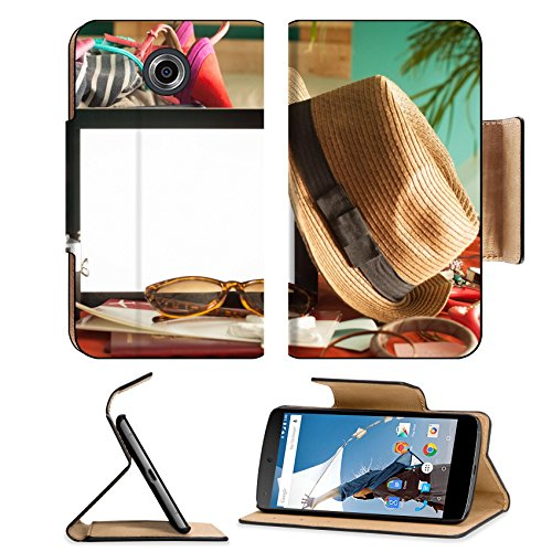 MSD Premium Motorola Google Nexus 6 Flip Pu Leather Wallet Case IMAGE ID 19487721 Digital tablet airline ticket and other accessories ready to be packed for summer holiday