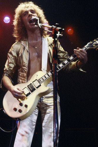 Peter Frampton plays guitar in concert 1970's in gold jacket 24x36 Poster