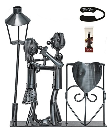 Fabulous Couple Standing and Holding Hands Next to a Lamp Post Near a Wine Stand That Has a Heart on It , Wine Bottle Holder Plus a Wine Foil Cutter and a Wine Bottle Vacuum Stopper