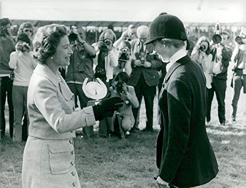 Vintage photo of Princess Anne receives the Raleigh trophy by her mother, Queen Elizabeth