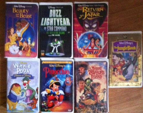 Disney Animated Classics 7 Pack - Beauty & the Beast, The Jungle Book, The Return of Jafar, Muppet Treasure Island, Pinocchio, Winnie the Pooh's Seasons of Giving,and Buzz Lightyear of Star Command