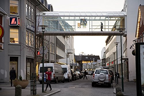 People walking on a pedestrian bridge and on Hafnarstraeti street, early morning. The bridge connects different parts of Landsbanki bank headquarters. Downtown Reykjavik, Iceland. 30x40 photo reprint by PickYourImage