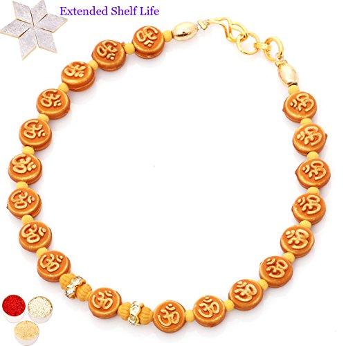 Rakhis online - Set of 2 BB-2102 Om Bracelet Rakhis with 200 gms of Kaju katli
