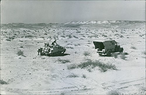 rican Field Service Aids Desert drive against axisA wounded man is transferred from a Bren gun carrier which had picked him up on the Libyan desert to an ambulance of the American Field Service. ()