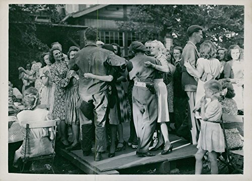 Vintage photo of Tommies and G.I.s dancing with blonde Frauleins in Berlin's open air cafe.Taken - Circa 1945