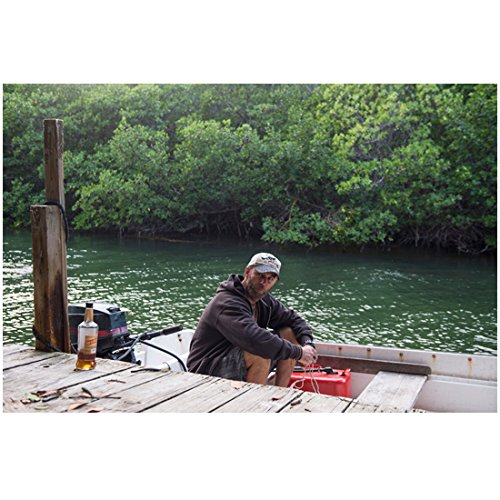 Bloodline Jamie McShane as Eric sitting in small craft by dock 8 x 10 Inch Photo