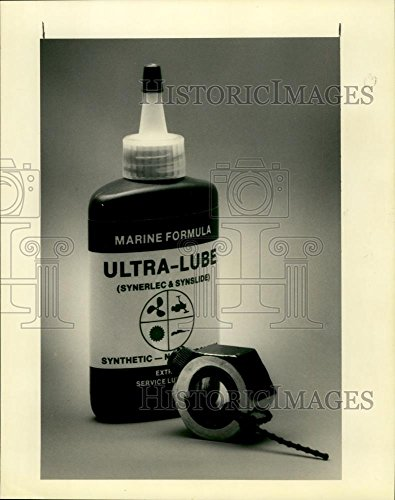 Vintage Photos 1990 Press Photo Cable Buddy Marine Formula Ultra-Lube Bottle - noa52666 (Cable Lube Buddy)