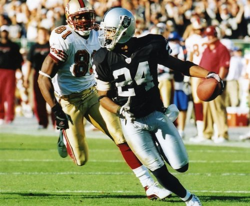 CHARLES WOODSON OAKLAND RAIDERS & TERRELL OWENS SAN FRANCISCO 49ERS 8X10 SPORTS ACTION PHOTO ()