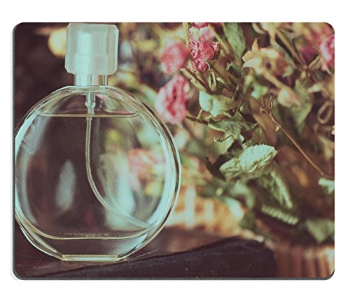 Care Discount Perfume (MSD Natural Rubber Mousepad perfume on a background of dried flowers IMAGE)