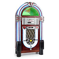 A jukebox true to the original with record player, MP3-capable CD player, Bluetoothfunction as well as FM tuner and AUX input. USB and SD port with music playback and recording function. Detailed design with LED lighting and light variation f...