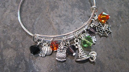 Halloween adjustable bangle bracelet with assorted charms and crystal beads in Halloween colors -