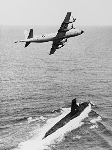 A U.S. Navy Lockheed P-3 Orion patrol plane flies over the