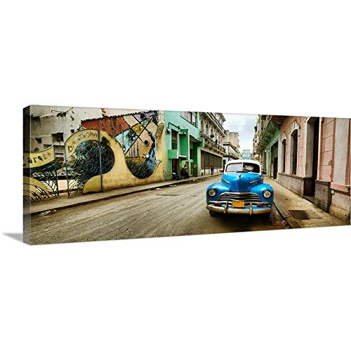 "GREATBIGCANVAS Gallery-Wrapped Canvas Entitled Old car and a Mural on a Street, Havana, Cuba by 60""x24"""