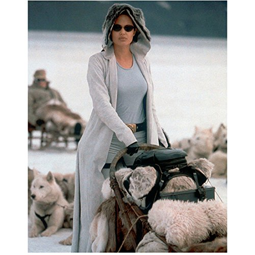 Angelina Jolie Lara Croft Tomb Raider Wearing Hooded Coat Sunglasses Holding Dog Sled White Dogs Laying in Background 8 X 10 Inch Photo
