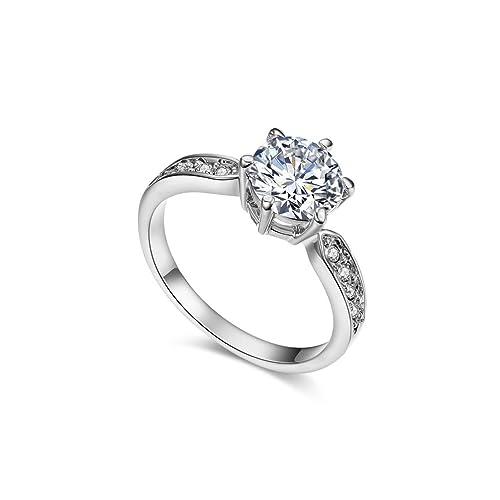 Anillo chapado en oro rosa de 18 K con 9 incrustaciones de cristal de RedFly, anillo de boda, anillo de compromiso, anillo de regalo: Amazon.es: Joyería