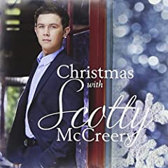 Contains 11 Holiday songs including classics like 'Let It Snow' and 'Winter Wonderland'. Also featuring the new songs 'Christmas In Heaven' and 'Christmas Comin' Round Again'.