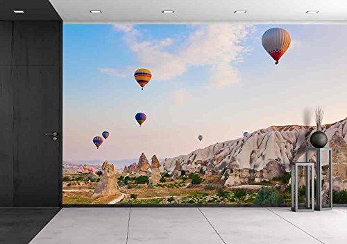 Hot Air Balloon Flying over Rock Landscape at Cappadocia Turkey