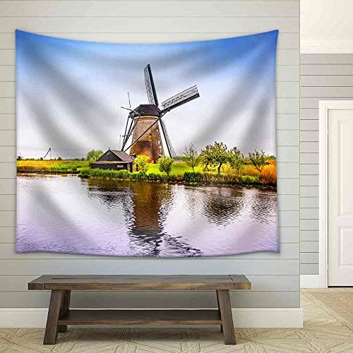 Windmills and Water Canal in Kinderdijk Holland or Netherlands Fabric Wall
