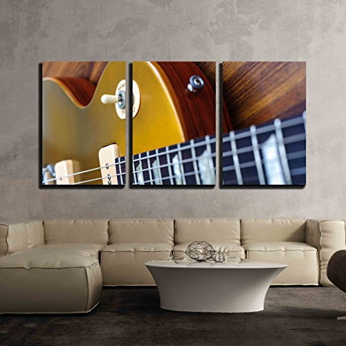 wall26 - 3 Piece Canvas Wall Art - Vintage Gold Top Single Cutaway Guitar on Wood Surface - Modern Home Decor Stretched and Framed Ready to Hang - 16