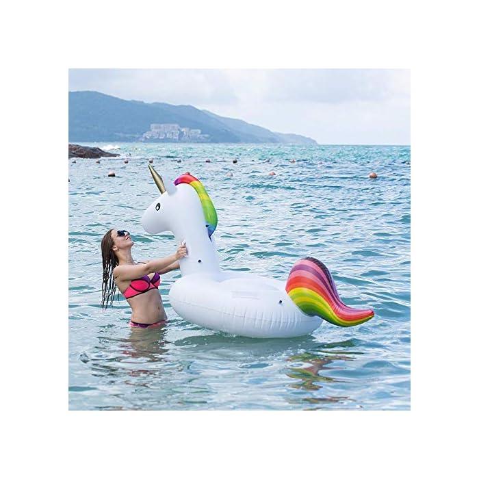 51abVdPG68L GIGANTE TAMAÑO - Capacidad de peso 220lb SEGURIDAD - Este anillo de natación unicornio viene con dos asas de seguridad en el cuello; Usted puede coger las manijas cuando usted está montando el juguete. DISEÑO AVANZADO - Un unicornio gigante muy lindo, hecho por el material ambiental del PVC, es grueso, suave y durable.