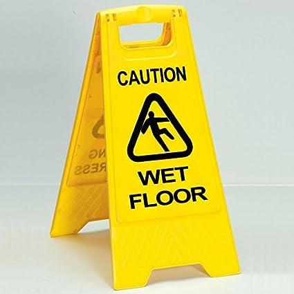 Robert Scott precaución por suelo mojado cartel: Amazon.es ...