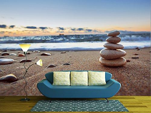 Stones balance on beach sunrise shot