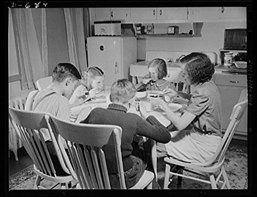 1941 Photo The Herbster family gets well-balanced meals. Mrs. Herbster plans to give the children milk; leafy, green or yellow vegetables; raw fruits or vegetables rich in Vitamin C; cereals and bread