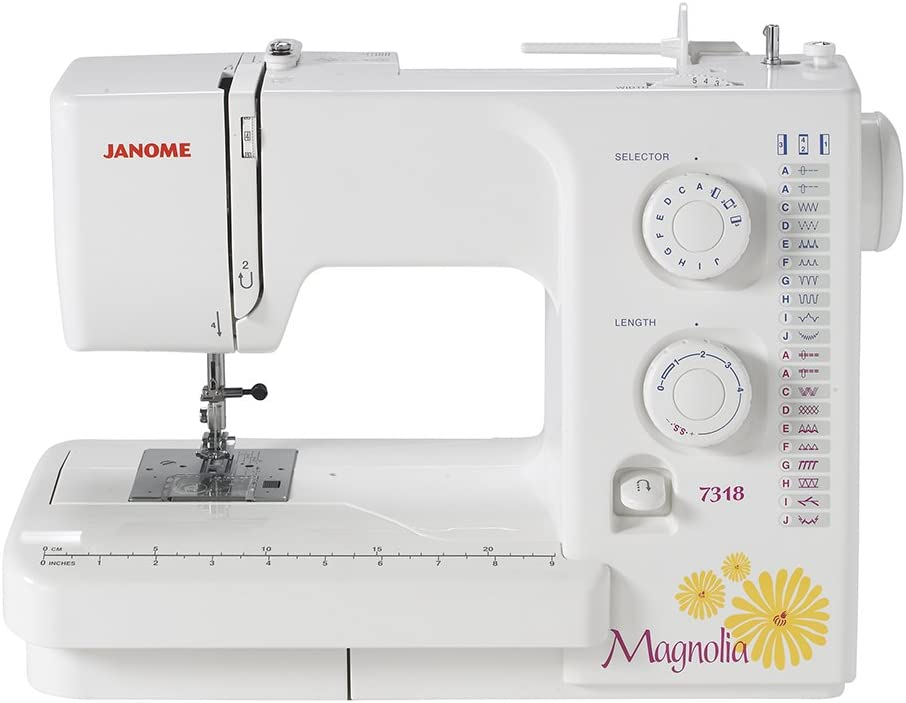 A Janome Sewing Machine with yellow flowers on it.