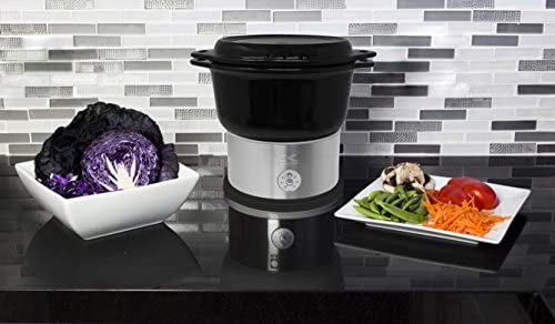 51aezvZY3GL. AC Kalorik All Natural BPA Free Ceramic Food Steamer, DG 44815 BK, Prepare Healthy Meals with Smart Digital One-touch Control, 4.5 Liter, Black    The black Kalorik digital ceramic steamer with steaming rack provides a healthy and easy way to to steam, and prepare a variety of foods! With a 4.5L capacity, this digital ceramic steamer comes in handy for cooking healthy dinners at any time. The unit provides a BPA-free ceramic pot and a steaming rack with removable handle, to steam food on 2 layers simultaneously. Other highlights include an adjustable 45-minute timer with easy one-touch-control, a lid, serving platter and drip-tray in one, and heat-resistant potholders. This unit is easy to put away thanks to its space-saving storage: the base and the rack fit inside the basket!