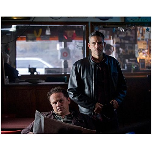Person of Interest (TV Series 2011 - ) 8 inch by 10 inch PHOTOGRAPH Jim Caviezel Black Leather Jacket Over Plaid Shirt Standing Behind Kevin Chapman Reading Newspaper kn