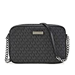 An iconic look, no matter where your day takes you. This Michael Kors® crossbody easily fits in your luggage for use while on your next trip or add her to your everyday rotation. Logo printed coated canvas. Zipper closure. Adjustable c...