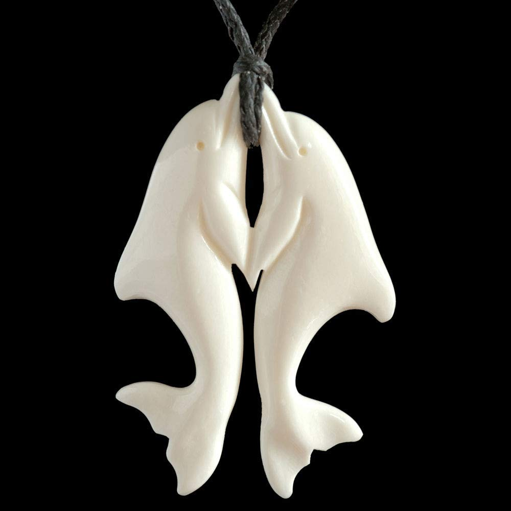 Amazon Com Small Carved Bone Playing Dolphins Pendant From New Zealand Handmade