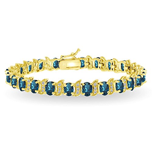 GemStar USA Yellow Gold Flashed Sterling Silver London Blue Topaz 6x4mm Oval and S Tennis Bracelet with White Topaz Accents