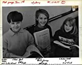 This is an original press photo. Pupils at Riverdale School (from left) Shane Hall, 10; Nathan Bonn Savage, 9; & Erika Zak, 8, read letters sent to President BushPhoto measures 10 x 8inches. Photo is dated 01-19-1989.