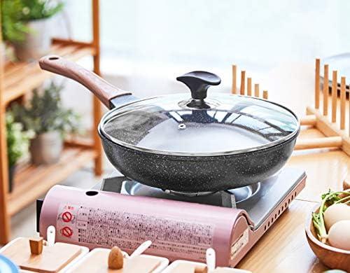 Poêle à frire noire avec couvercle anti-adhérent 26 cm de long et 5,8 cm de haut.