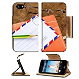Luxlady Premium Apple iPhone 5 iphone 5S Flip Pu Leather Wallet Case IMAGE 28228036 White vintage envelope pencils notebook and glasses on a wood floor