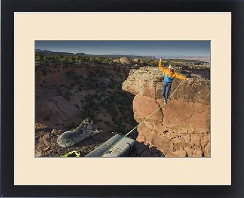 Framed Print of Larry Harpe highlining (slacklining) between Navaho Sandstone Towers with his by Fine Art Storehouse