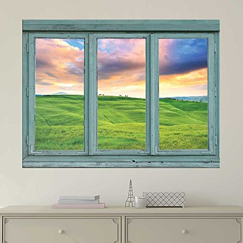 Pastel sunset over green rolling hills Spring farmland during a sunset Wall Mural