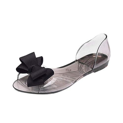 Sandalias planas transparentes con lazo en la punta. Opción de colores.