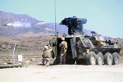 Reconnaissance Tank (LAMINATED POSTER Marines serving with Alpha Company, 1st Light Armored Reconnaissance Battalion, fire the anti-tank g...)