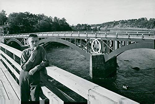 Vintage photo of Bengt197;ke S246;derkvist poses against the backdrop of196;lvkarleby39;s newly restored bridge, Carl XIII39;s ()