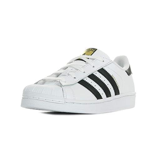 timeless design bf762 a7a1c adidas Superstar C, Zapatillas de Gimnasia Unisex Niños  Amazon.es  Zapatos  y complementos