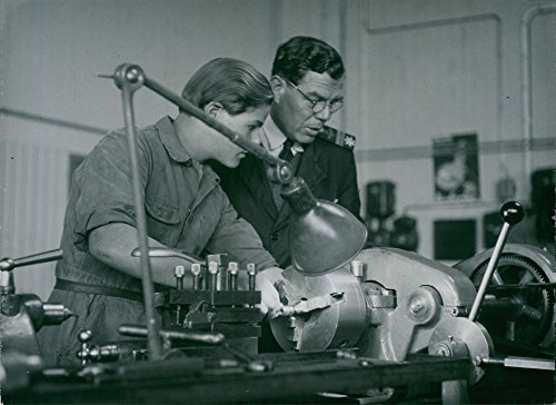 Vintage photo of Master works at the airport administration apprentice school shows an operation at the lathe.