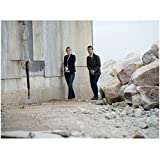 Haven Emily Rose as Audrey Parker and Lucas Bryant as Nathan Wuornos Holding Guns Near Large Rocks and Building 8 x 10 inch photo