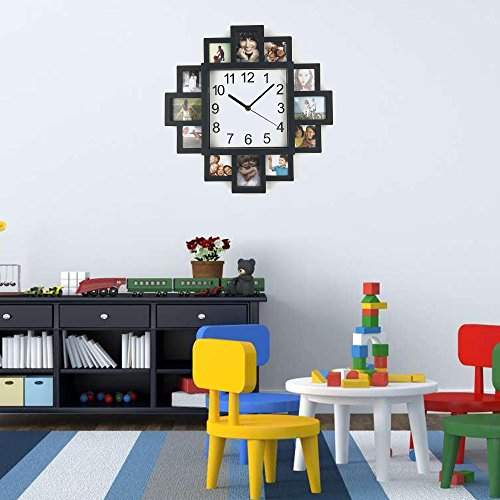 Picture frame wall clock is displayed on an empty wall above a desk cabinet in a children's playroom.