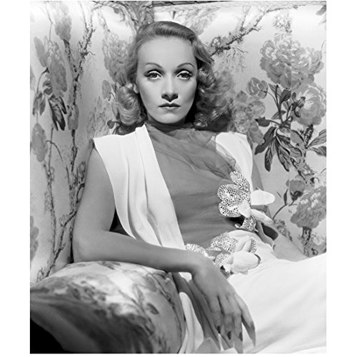 Marlene Dietrich reclining against a floral backdrop Black and White 8 x 10 Inch ()