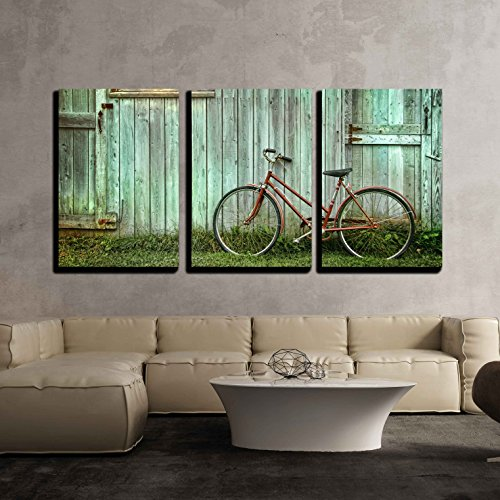Old Bicycle Leaning Against Grungy Barn x3 Panels