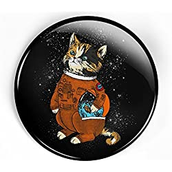 Astronaut cat pin button with space suit and helmet looking across the galaxy and the stars