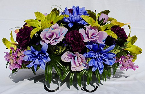 Spring Cemetery Flowers made into a Saddle Arrangement with Lavender Roses, Green Easter Lilies, Purple Peonies and Blue Dahlia, and Yellow Calla Lily