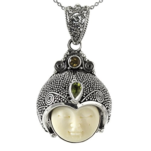 (Carved Bone Face Pendant with Peridot and Citrine Stones)